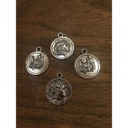 Münze mit Kopfform, Rückseite sitzende..